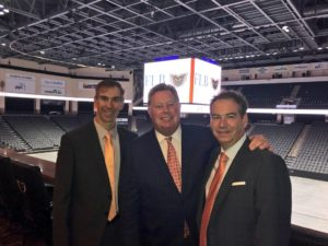 Photo of Jim Brooks, Joe Fitzpatrick and Rob Brooks at the PPL Center in Allentown, PA with the hockey arena behind them.