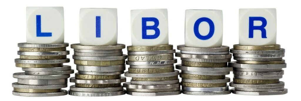 Stacks of coins with the letters LIBOR isolated on white background