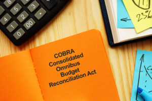 Photo of words COBRA Consolidated Omnibus Budget Reconciliation Act